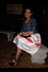 sitting in skirt